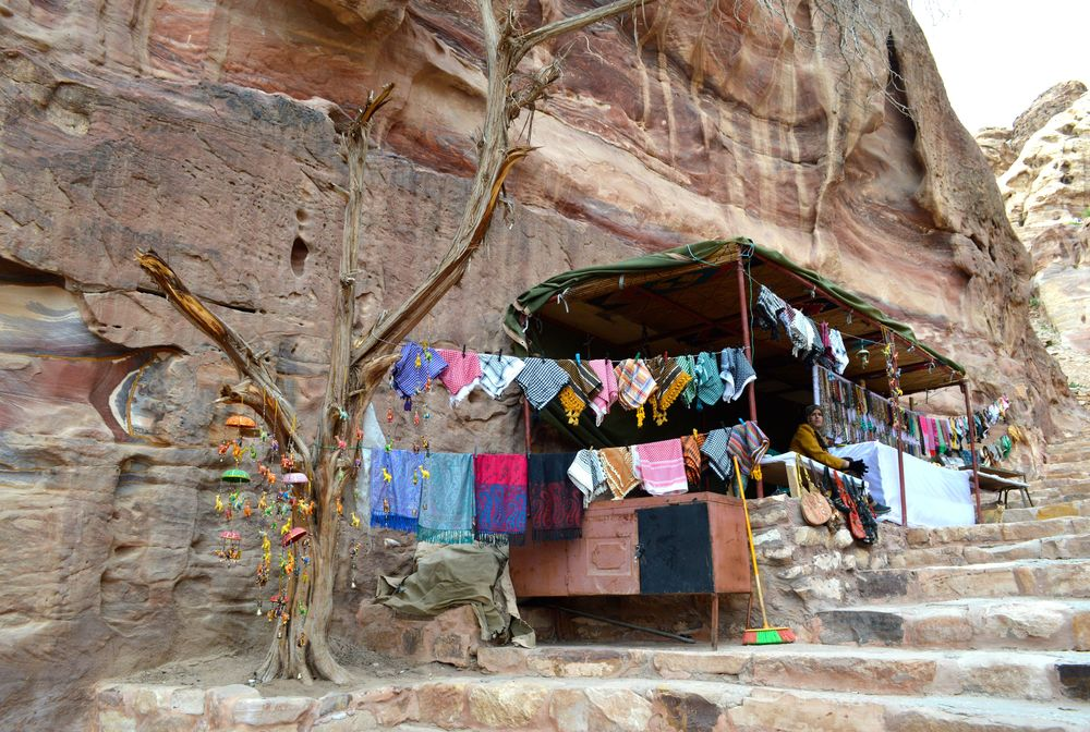 A family selling their local gifts in a market in Petra